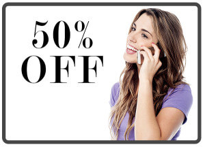 Cheerful woman talking on cell phone over white